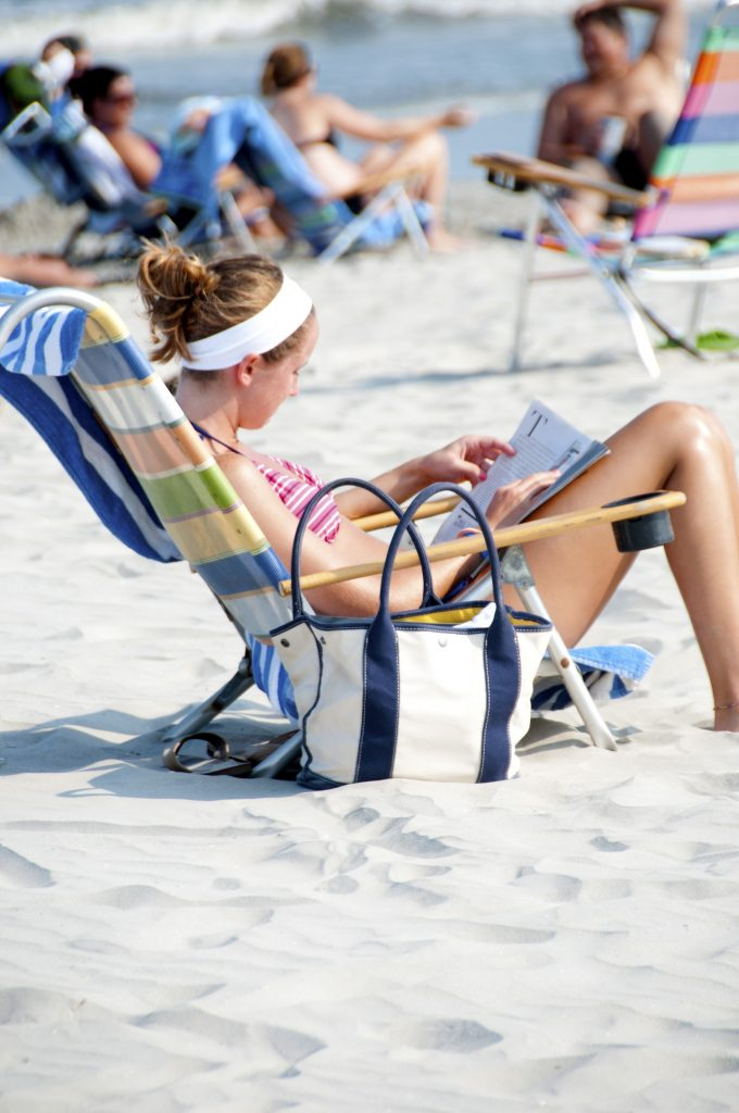 woman, beach, sitting, back, spine, low back pain, happy, healthy